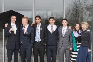 Standing in the Rain  from Left: Elder Gappmayer, Elder McDaniel, Elder McArthur, Elder Erickson, Elder Mantle, Sister Burgess, Sister Gardner