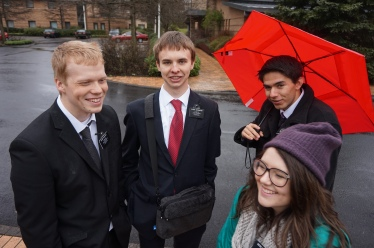 Enjoying the Rain.  Elder McDaniel, Elder Gappmayer, Elder McArthur and Sister Burgess